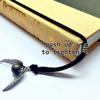 Winged Golden Sphere Bookmark: suede cord with flying gold ball charm (adjustable & no-slip)