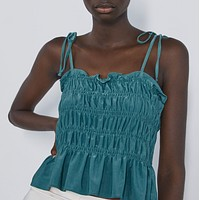 Pleated tops with straps are popular for women's wear a