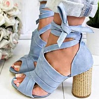 Fashion large size sandals with thick heels and high heels and cross straps