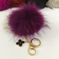 Fur pom pom keychain, bag pendant with flower charm in purple with black markings color tone