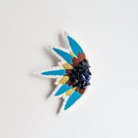 Abstract embroidered brooch starburst design with blue, yellow and tan colors and blue lapis gems Spring Summer fashion