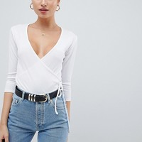 PrettyLittleThing Ribbed Wrap Top at asos.com