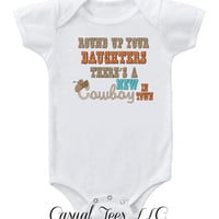 Round Up Your Daughters, there's a new Cowboy in Town Baby Bodysuit or Toddler Tee