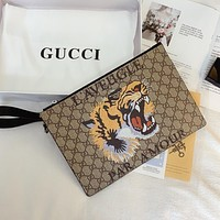 GUCCI men's and women's classic tiger head retro printed logo clutch bag wash bag