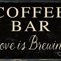 Coffee bar love is brewing wooden sign.  Handmade.  Approx. 11x14x2 inches.  Heavy nice sign that stands up on its' own.