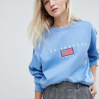 Daisy Street relaxed sweatshirt with vintage los angeles embroidery at asos.com