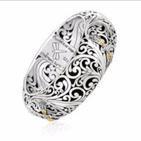 Hinged Bangle with Scrollwork and Dragonfly Design in 18K Yellow Gold and Sterling Silver