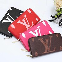 Louis Vuitton LV classic printed letters men and women zipper small wallet long clutch cosmetic bag
