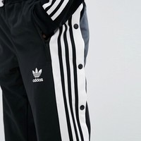 adidas Originals Popper Track Pant In Black at asos.com