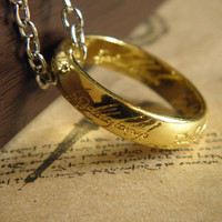 bright gold lord of the rings necklace with a chain