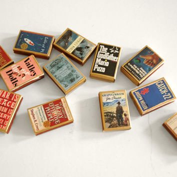 Twelve (12) Book Covered Matchboxes