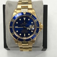 Rolex Submariner 16618 Blue 18K Yellow Gold Watch with Service Paper