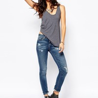 Blank NYC Skinny Jeans With All Over Rips & Distressing at asos.com