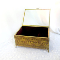 Vintage Vanity Music Box Engraved Gold Tone Metal With Glass Lid Plays Song Never On A Sunday Red Velour Lining Collectible Gift Item 1712