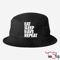 Eat Sleep Rave Repeats bucket hat