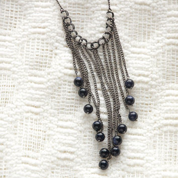 glittery indigo stone beads and gunmetal toned chain necklace
