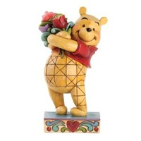 Enesco Disney Traditions by Jim Shore Winnie the Pooh with Flowers Figurine, 6.375-Inch