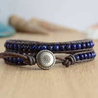 Dark blue boho chic leather wrap bracelet. Beaded lapis lazuli jewelry