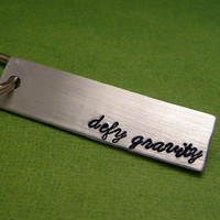 Wicked Inspired - Defy Gravity - A Hand Stamped Aluminum Keychain