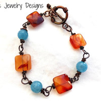 Gemstone and Copper metal bracelet. Orange and blue stone jewelry.