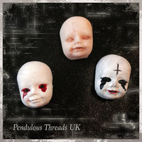 Creepy dolls head rings
