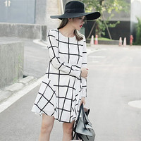 women plaid dress in black and white featuring long sleeve,Minimalist,short length,Asymmetrical,checked,fashion design.for autumn and winter