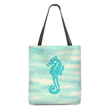 Seahorse Tote Bag on sea and sand with bubbles