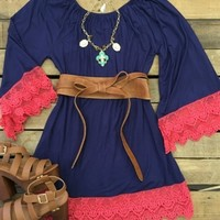 Long sleeve dress with scope neck and lace tim around the bottom and on the sleeves.