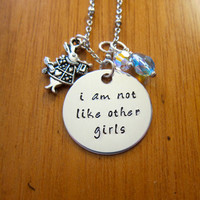 """Disney's """"Alice in Wonderland"""" Inspired Necklace. """"I am not like other girls"""". Silver colored. Swarovski crystals."""