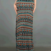 Keep your wardrobe up to date with this My Perfect Tribal Print Maxi Skirt. This floor length maxi skirt features a light weight jersey knit, tribal print throughout, and a wide cuff down waist band with elastic detailing. Pair with crop top, sandals and s
