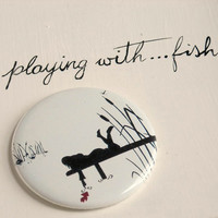 pocket mirror black & white silhouette  playing withfish by ollina
