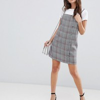 ASOS DESIGN square neck mini dress with buttons in check at asos.com