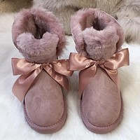 UGG Mini bow snow boots