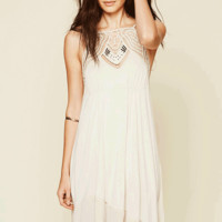 Featuring slip on style solid jersey fabrication with crochet design at square neckline with metal jew detailing, low scoop back, double shoulder spaghetti straps, elastic ruching at bust, high-low hem, contrasting crochet trim hem. Fully lined.