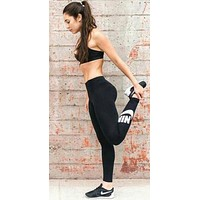 NIKE Tide brand solid color female yoga fitness running slim bottoming trousers