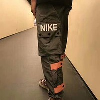 NIKE retro overalls tide brand thin section sports loose quick-drying nylon functional pants F-AG-CLWM green