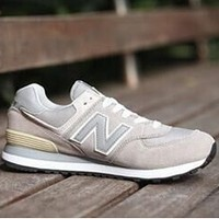 New Balance 2018 new men and women tide brand fashion couple sports shoes grey