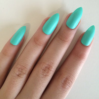 Matte green stiletto nails, hand painted acrylic nails, fake nails, false nails, stick on nails, nail art, nail designs, artificial nails