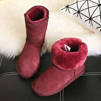 U UGG boots sell well for women with velvety mid-barrel snow boots