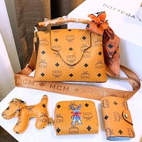 MCM classic printed messenger bag coin purse card holder dog pendant four-piece set