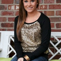Black sweater with gold sequins