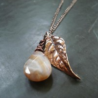 Nature inspired leaf necklace made of copper with gemstone