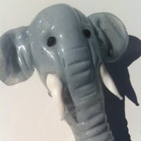 Hand sculpted elephant head glass pipe
