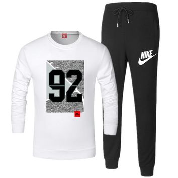 NIKE 2018 autumn and winter new casual men's cardigan sports trousers two-piece White