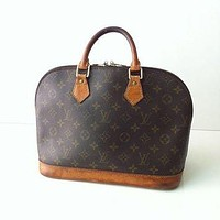 Vintage Authentic Louis Vuitton Alma Bag