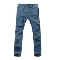 Allegra K Men Drawstring Elastic Waist Slant Pockets Harem Pants Blue W32