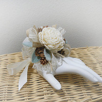 Rustic Wrist Corsage handmade of sola flowers, pinecones, jute ribbon, lace, dusty miller leaves and satin ribbon. Made to Order.