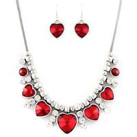 """red crystal heart necklace and earring set at Joji Boutique: 16"""" silver snake chain with 3"""" extender chain. 5 beveled red heart charms graduating from 1cm to 2cm, with clear bejeweled spacer charms. Matching red stone heart earrings. #jewelry #joji #fashio"""