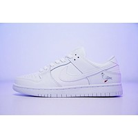staple x nike sb dunk low sneaker peace dov 304292 100