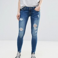 Only Coral Destroyed Skinny Jeans at asos.com
